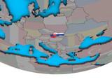 Slovakia with embedded national flag on simple political 3D globe.