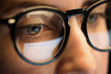 vision, business and education concept - close up of woman eyes in glasses looking at computer screen - 232270520