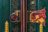 Ornate doorhandle and knocker of St. Georg church in Ulm, Germany - 232271357