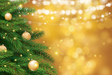 Christmas tree with gold blur bokeh lights background. Vector illustration for cover, banner, greeting card template.