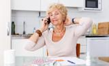 Woman among pills calling to doctor - 232299741
