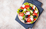 Traditional Greek salad with feta, olives and vegetables - 232301318