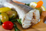 Tail of hake by rustically frying and served with boiled potatoes and tomatoes - 232302126