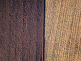 Aerial photo of a ploughed field in a countryside - 232302349