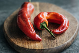 food photography. red pepper on a wooden Board. Gray background and the light of day.  macro photography