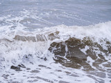 Waves at the seashore. Selective focus with shallow depth of field. - 232311734