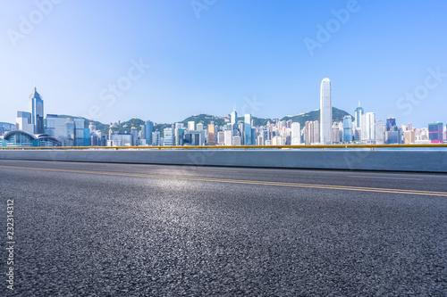 Poster empty asphalt road with city skyline
