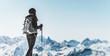 Athletic woman trekking in a winter landscape