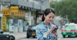 Woman use of mobile phone in city - 232324137