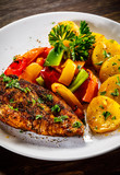 Grilled chicken fillet and vegetables on woowde table - 232332506