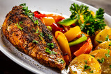 Grilled chicken fillet and vegetables on woowde table - 232332546