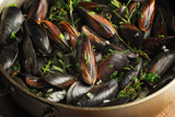 mussel with parsley, onions, wine sauce  in a large pan - 232348556