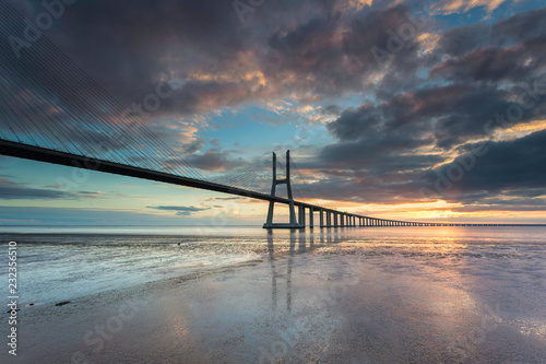Vasco da Gama Bridge over Tagus River in Lisbon, Portugal, at sunrise