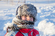 Leinwandbild Motiv Adorable smiling boy at the snow background
