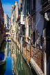 Venice canal with boats and old architecture
