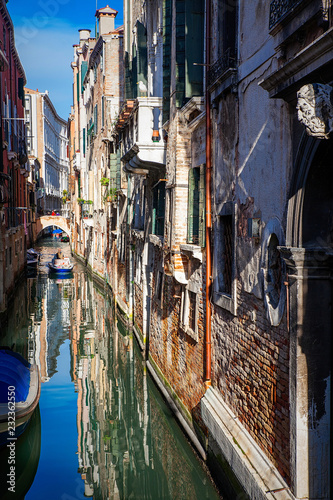 Venice canal with boats and old architecture - 232362550