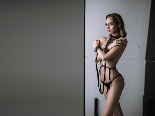 beautiful sexy naked girl in bdsm