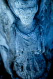 Beautiful ancient sculpture of an angel with dark background - 232385796