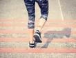 Leinwanddruck Bild - Woman walking down the stair