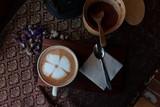 Fresh hot coffee On a wooden chopping board  - 232414193