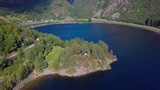 Island on a lake in Norway - 232421353