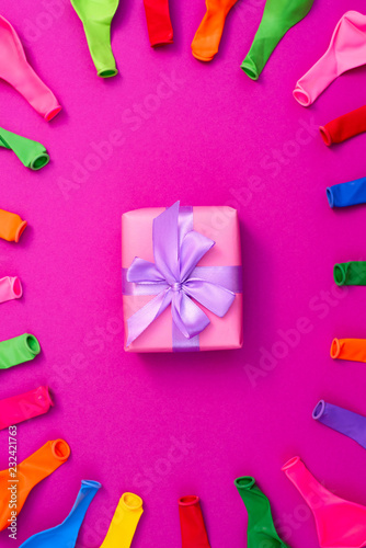 Set of colored balloons on pink background Flat lay top view