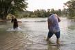 Leinwanddruck Bild - young men having fun with water guns