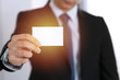 Businessman's hand holding business card with empty space, close-up
