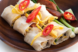 Thai Steamed Rice Noodle Rolls on wood background - 232438560