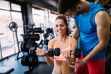 Working out in fitness center - 232443747