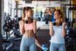 Leinwanddruck Bild - Beautiful women working out in gym