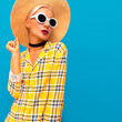 Fashion Model in a straw hat and checkered shirt.   Country Stylish accessories