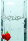 A Strawberry Splashes into a Jar of Water