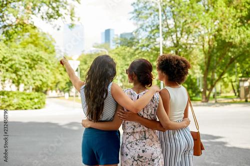 Leinwandbild Motiv female friendship, people and leisure - young women or friends hugging at summer park