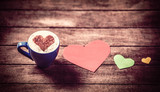Cup with coffee and heart shape papers on wooden table. - 232455729