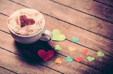 Cup with coffee and heart shape papers on wooden table. - 232455732