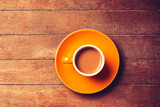 yellow cup of coffee with milk on a wooden table. Aboe view - 232455790