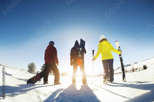 Skiers and snowboarders ski resort concept - 232459735