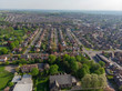 Typical UK Town aerial photo showing rows of houses, roads, parks and communal area
