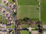 Typical UK Town aerial photo showing rows of houses, roads, parks and communal area - 232463107
