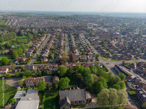 Poster Typical UK Town aerial photo showing rows of houses, roads, parks and communal area