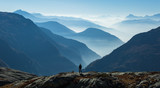 Man looking at the foggy, blue layers of mountains. Near Chamonix, France. - 232463583