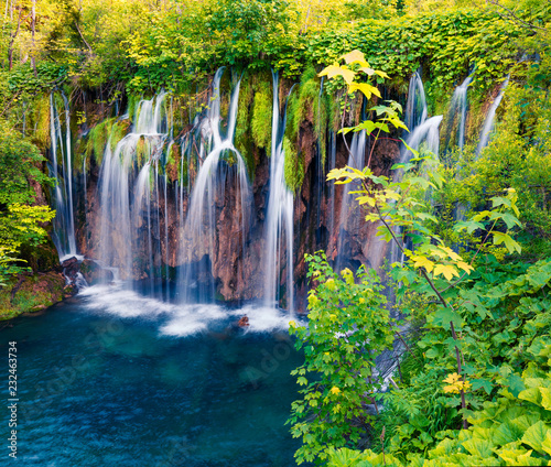 Colorful spring scene of green forest with pure water waterfall in Plitvice National Park. Great countryside landscape of Croatia, Europe. Beauty of nature concept background. © jojjik