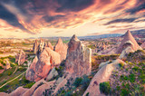 Unreal world of Cappadocia. Impressive sunrise in Red Rose valley in April. Cavusin village located, district of Avanos in Nevsehir Province in the Cappadocia region of Turkey, Asia.