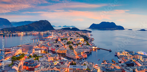 From the bird's eye view of Alesund port town on the west coast of Norway, at the entrance to the Geirangerfjord. Colorful sunset in the Nord. Traveling concept background. © jojjik