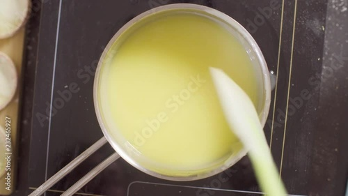 Wall mural Top view. Close up hands of a confectioner pouring lemon curd into plastic bag
