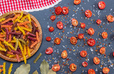 unprepared multi-colored pasta spiral made from wheat flour - 232466534