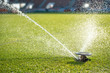 Watering grass at the football stadium