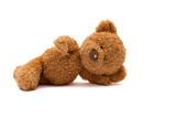 lying teddy bear isolated on white background - 232468595