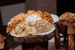 Plate with dry snacks on the table